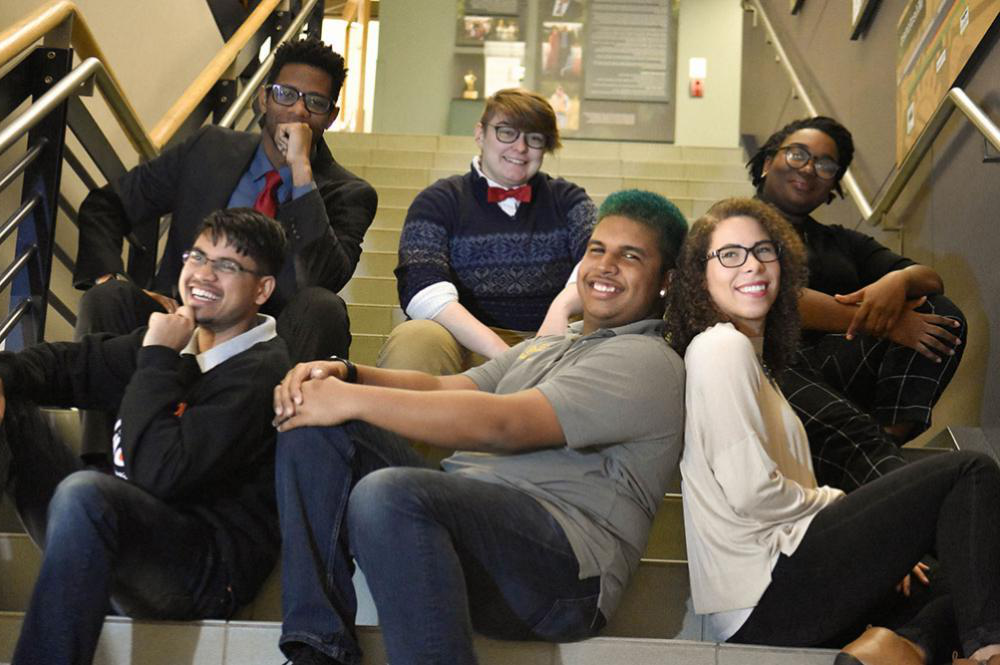 Community of Underrepresented Professional Opportunities (CUPO) sitting on stairs