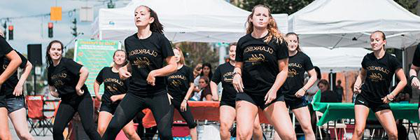 克拉克森大学 undergraduate students on the Goldies Dance Team perform a routine in downtown Potsdam.