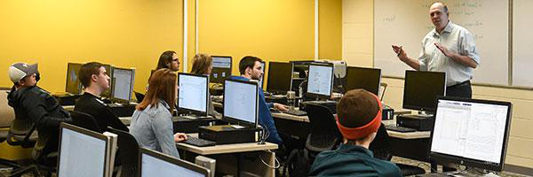 Clarkson Mathematics Professor Joe Skufca teaches an undergraduate class of students